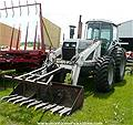 Picture: White 2-85FWA Tractor w/CAH, FEL & Grapple  5600Hrs