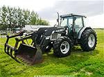 Picture: 1998 White 6410 MFWD Tractor  70HP w/ Alo Quicke 340 FEL, 84 Bucket & Grapple, 2 Spool Hyd, 540/100 PTO, 12x2 Trans, 3PT, GRP, Joystick, 18.4R38 Rear Rubber