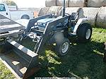 Picture: 1989 Ford 1520 4WD Diesel Compact Tractor w/3PT, E-Z On FEL